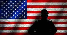 Silhouette Of An American Soldier In Military Beret Facing Grunge Style USA National Flag. Concept: United States Army, Veterans Day, Memorial Day, Armed Forces Day, Other US Military Services