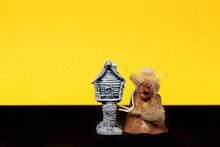 Happy Halloween. Baba Yaga With A Hut On Chicken Legs On A Yellow Background. Isolated Space For Your Text.