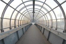 Empty Modern Pedestrian Bridge With Metal Arches