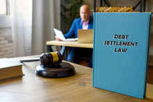 DEBT SETTLEMENT LAW Book In The Hands Of A Attorney. Debt Settlementis A Settlement Negotiated With A Debtor's Unsecured Creditor.