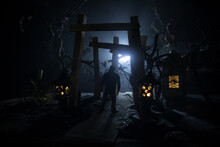 Creative Artwork Decoration. Abstract Japanese Style Wooden Tunnel At Night. Selective Focus
