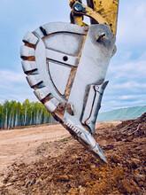 Excavator Steel Bucket Lying On The Ground.
