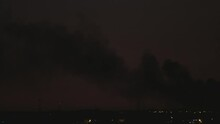 Plume Of Smoke Above City At Sunset - Smoke Clouds From Fire In An Urban Area - Timelapse