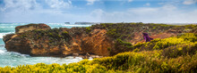 Panorama Of Rock Coast, Where Happy Girl Walks Between Thickets Looking At Ocean