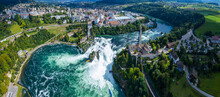 Aerial View Of The Waterfall Beside Schaffhausen In Switzerland On A Sunny Day In Summer.