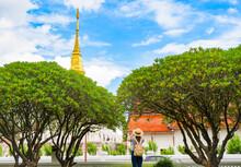 Woman Traveler  On Huge Ancient Wat Phra That Chang Kham  In Nan Provice, Thailand.