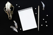 White Notebook Mockup Template On Black Background With Magical Mysterious Mood.