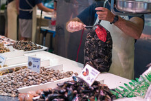 Fish Market, The Seller Opens A Bag Of Clams