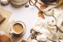 Warm Coffee With Pumpkins And Colorful Leaves Over White Background Top View. Stylish Autumn Flat Lay. Hello Fall. Cozy Warm Image
