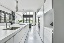 Minimalist Interior Of Modern Kitchen With White Furniture