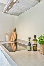 Kitchen Utensils Near Built In Stove Under Hood