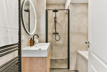 Shower Cabin And Sink With Bathtub In Bathroom