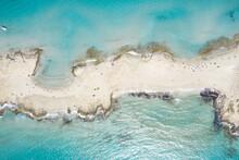 Island Between Rippled Sea On Sunny Day