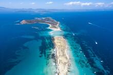 Island Between Sea With Motorboats In Summer