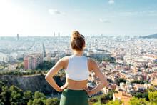 Unrecognizable Sportswoman Contemplating City Under Cloudy Sky