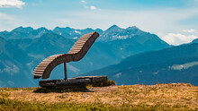 Beautiful Alpine Summer View With A Wooden Bench At The Famous Rossbrand Summit Near Filzmoos, Salzburg, Austria