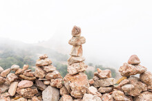 Stones Stacked In Pile In Foggy Highland