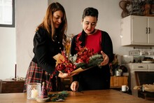 Women Making Christmas Bouquets Together