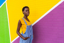 Black Woman Standing Against Colorful Wall