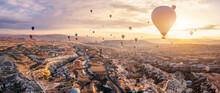 Hot Air Balloons Flying Above Göreme, Cappadocia (Kapadokya) Anatolia, Turkey At Sunrise. Panoramic View Of Villages And Fairy Chimneys. Popular Touristic Destination For Summer Vacation Holidays