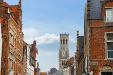 Bruges Historic Gable Along The Steenstraat And The Famous Belfry Bell Tower As A Symbol Of The City, Belgium