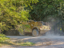 British Army Supacat Jackal (MWMIK) Rapid Assault, Fire Support And Reconnaissance Vehicle In Action On A Military Exercise, Salisbury Plain UK