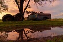 Farm Equipment At Sunset