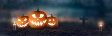Jack O 'Lanterns Pumpkins With Spooky Glowing Eyes On Halloween Night