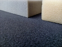 Square Piece Of Thick Gray, Yellow And Black Sponge Foam. Block Material With Coarse Texture And Pore