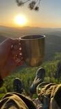 Fototapeta Kawa jest smaczna - Midsection Of Man Holding Drink Against Sky During Sunset