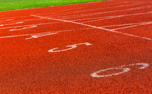 Red Markings On The Racetrack At The Stadium