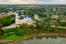 Cathedral With Blue Domes And Belfry Decorated With Clock On Bank Of Kashinka River In Ancient Township Of Kashin In Tver Oblast Of Russia