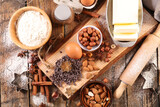 baking food ingredient- flour, butter, rolling pin, chocolate and nuts