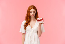 Sad, Uneasy And Depressed Cute Redhead Girl Feeling Lonely Or Heartbroken, Eating Not To Think Bad Thoughts, Holding Peace Cake And Looking Distressed At Dessert, Sighing Upset