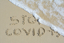 Stop Covid-19 Word On Sand At Samui Island In Thailand On Travel And Medical Concept