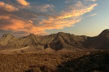 Rocky Hills Under Sunset Sky