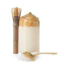 Glass Of Tasty Dalgona Hojicha Latte, Chasen With Powder On White Background