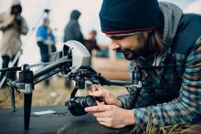 Man Pilot Checking Quadcopter Drone Camera Before Aerial Flight And Filming