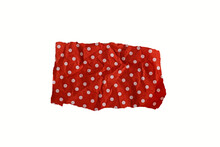 Torn Piece Of Red Paper With White Polka Dots Isolated On White Background.