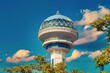 canvas print picture - Atakule behind the branches. Symbol of Ankara in front of sky. Popular touristic landmark of the capital city with 125m height. Ufo shaped dome is an example of modern architecture.