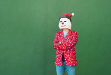 Anonymous Person Dressed In Christmas Clothes Standing With Arms Crossed