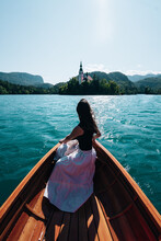 A Woman On A Boat Riding Towards The Island Of Bled, Slovenia