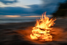 Fire Flames Burning On The Beach At Night
