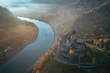 Sunrise Over A Misty Cochem In Germany