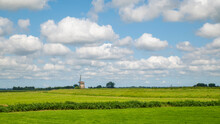 Landscape In North Holland, Netherlands. Panoramic Grassland, Clouds, Windmill On The Horizon And Horses
