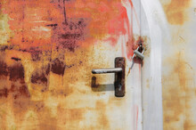Closeup Shot Of An Old Rusted Door With A Lock