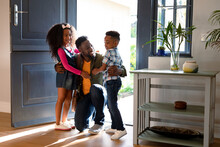 Happy African American Children Welcoming Their Father Coming Back Home