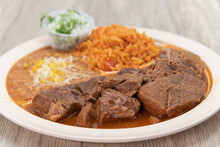 Birria Beef Meat, Slow Cooked To Perfection On A Plate With Mexican Rice And Beans For A Hearty Meal