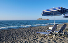 Empty Sunbeds At The Beach Of The Hotel, Crete Island
