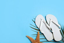 Stylish Flip Flops And Starfish On Light Blue Background, Flat Lay. Space For Text